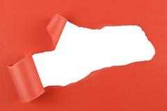 Sönderriven röd pappers- bakgrund Fotografering för Bildbyråer
