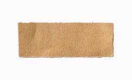 Sönderrivet ark för brunt papper på vit Royaltyfri Bild