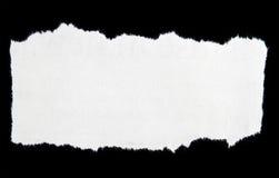 Sönderrivet papper arkivbild