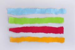 Sönderrivna färgrika pappers- remsor Royaltyfri Bild
