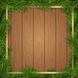 Sörja ramen för fyrkanten för trädfilialer på träbakgrund Royaltyfria Foton