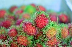 Söt fruktrambutan i marknaden Royaltyfri Fotografi