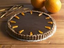 Söt matefterrätt, chokladkaka och apelsin Royaltyfria Bilder