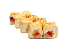 Söt sushi med bananen, jordgubbar och ost Arkivfoto