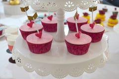 Söta muffin & älsklingpilar Arkivfoton