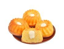 Söta muffiner på plätera Royaltyfri Fotografi