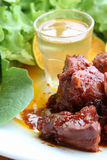 Söta och sura grisköttstöd Arkivbild