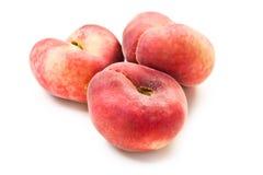 söta plana persikor Arkivbild
