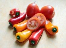 söta tomater för peppar Arkivfoton