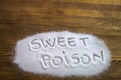 SÖTT GIFT som är skriftligt på högen av socker Royaltyfri Bild