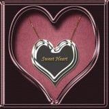 sött hjärtahalsbandhänge arkivfoto