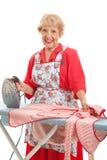 Süße alte Dame Ironing stockfotos