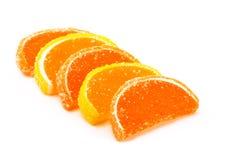 Süße Fruchtsüßigkeit auf einem weißen Hintergrund Stockbild