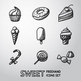 Süße handdrawn Ikonen stellten mit - kleinem Kuchen, Donut ein Stockbilder