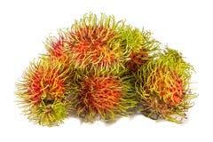 Süße köstliche Frucht des roten Rambutan auf weißem Hintergrund stockfotos