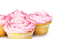 Kleine Kuchen mit dem rosa Bereifen Stockbilder