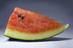 Süße Wassermelone auf hellem Hintergrund lizenzfreie stockfotos