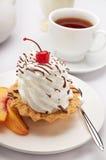 Süßer Nachtisch und Tee Stockbilder
