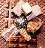 Süßer Nahrungsmittelschokoladen-Nachtischhintergrund Stockfotos