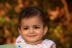 Süßes Gesicht eines kleinen Schätzchens Lizenzfreie Stockfotografie