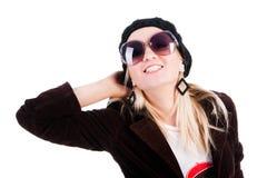 Süßes lächelndes Mädchen in den Gläsern lizenzfreie stockfotos