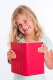 Süßes Mädchen mit rotem Buch vor weißem Hintergrund Stockfotografie