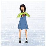 Süßes Mädchen mit rotem Herzsymbol der Liebe Stockfoto