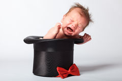 Süßes nettes Baby im silk Hut Stockfoto