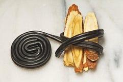 Süßholz roh und Süßigkeit Lizenzfreie Stockbilder