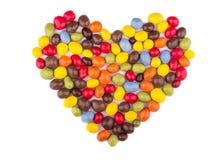 Süßigkeit färbte Glasur in Form des Herzens als Symbol der Liebe Stockbild