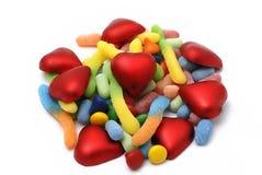 Süßigkeit, Geleebonbone und rotes Inneres Lizenzfreies Stockfoto