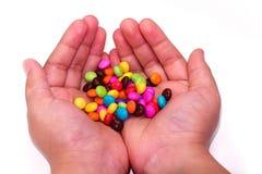 Süßigkeit an Hand Lizenzfreies Stockbild