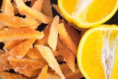 Süßigkeiten von der orange Schale Lizenzfreie Stockfotografie