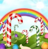 Süßigkeitsgartenhintergrund mit Regenbogen Stockfoto