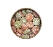 Süßigkeitslutscher in einem Zinnkasten Lizenzfreies Stockbild