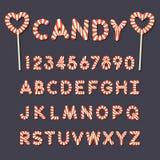 Süßigkeitslutscheralphabetbuchstaben und -zahlen Stockbilder