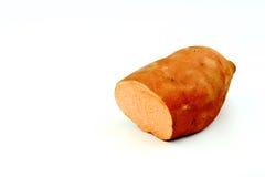 Süßkartoffel auf einfachem weißem Hintergrund Stockfotografie