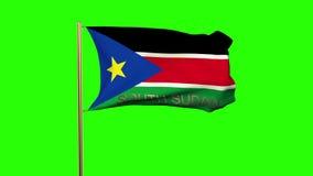 Süd-Sudan-Flagge mit dem Titel, der in den Wind wellenartig bewegt vektor abbildung