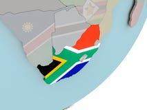 Südafrika auf Kugel mit Flaggen Lizenzfreie Stockfotos