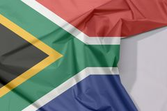 Südafrika-Gewebeflaggenkrepp und -falte mit Leerraum lizenzfreie stockbilder