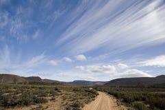 Südafrika-Landschaft mit ausgedehnten Wolken Stockfotografie