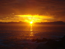 Südafrikanischer Sonnenuntergang über dem Meer Lizenzfreies Stockbild