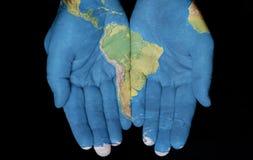 Südamerika in unseren Händen Stockfoto