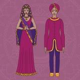 Südasien-Schönheit und -mann, die indischen traditionellen Stoff, Hinduismuskostüm, Sari auf Hintergrund tragen Lizenzfreie Stockbilder