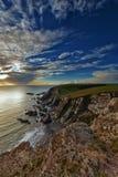 Süddevon-Küste-Sonnenuntergang lizenzfreie stockbilder