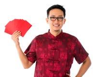 Südostasiatischer Mann im cheongsam Stockfotografie