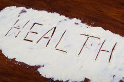 Słów zdrowie pisać w stevia proszku na drewnianym tle Fotografia Royalty Free