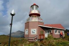 Sławna latarnia morska przy przylądka rogiem - południowy punkt archipelag Tierra Del Fuego, myjący nawadnia Drake Zdjęcia Stock
