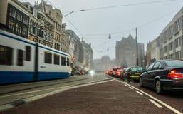 Sławni budynki i miejsce Amsterdam centrum miasta przy słońce ustalonym czasem Generała krajobrazu widok Fotografia Royalty Free