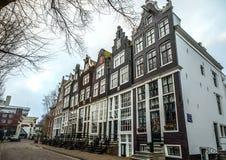 Sławni budynki i miejsce Amsterdam centrum miasta przy słońce ustalonym czasem Generała krajobrazu widok Zdjęcia Stock